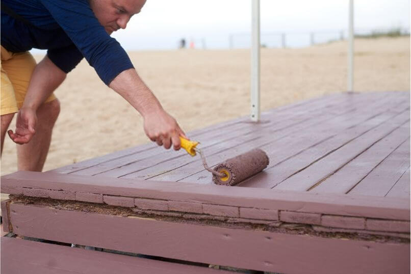how to stain a deck with a roller