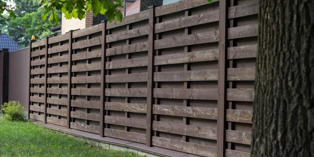 how long to wait to stain a new pine fence