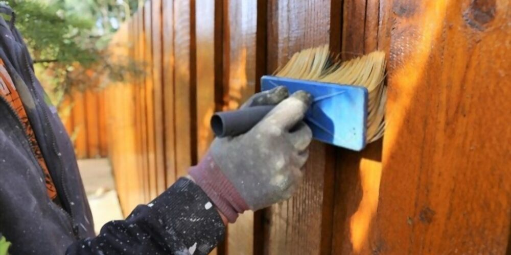 when should you stain a new fence